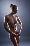 Beautiful nude woman with wet perfect body Stock Image