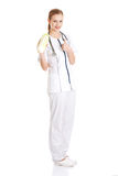 Beautiful nurse or doctor is holding green fresh lettuce. Stock Photos