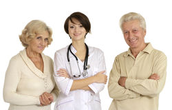 Beautiful nurse with elderly patient Stock Photo