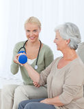 Beautiful nurse helping her patient Royalty Free Stock Images