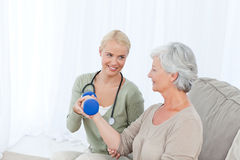 Beautiful nurse helping her patient Stock Photography