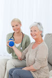 Beautiful nurse helping her patient Royalty Free Stock Photo