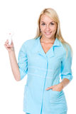 Beautiful nurse holding asthma inhaler. Isolated Royalty Free Stock Images