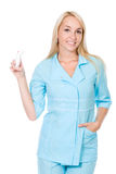 Beautiful nurse holding asthma inhaler Stock Photo