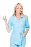 Beautiful nurse holding asthma inhaler. Isolated on white Stock Photo