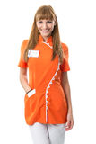 Beautiful nurse portrait in orange work clothing Royalty Free Stock Image