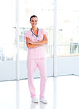 Beautiful nurse standing with folded arms Royalty Free Stock Photos