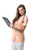 Beautiful Nurse writing document Stock Photos