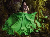 Beautiful nymph in fairy forest. Beautiful nymph in the fairy forest. Fashion photo Royalty Free Stock Image