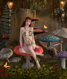 Beautiful nymph sits on a mushroom Royalty Free Stock Photo