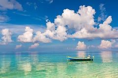 Beautiful ocean beach and boat Stock Images