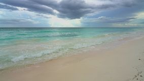 Beautiful ocean beach in Dominican Republic. At stormy day stock video footage