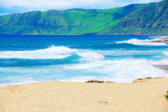 Beautiful ocean coastline of Hawaii, waves crashing on beach Stock Images