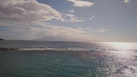 Excitcing shot of blue pacific ocean under cloudy sky on island maui,hawaii stock video