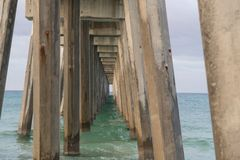 A beautiful ocean pier extends out stock photography