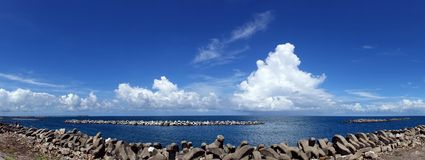 Beautiful Ocean and Sky View with Breakwaters Royalty Free Stock Images