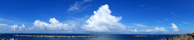 Beautiful Ocean and Sky View with Breakwaters Stock Photography