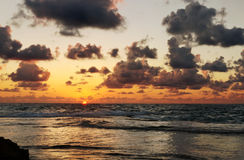 Beautiful ocean sunset. And cloudy sky royalty free stock photography