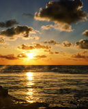 Beautiful ocean sunset. And cloudy sky in portrait royalty free stock images