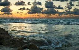 Beautiful ocean sunset. Beautiful ocean waterfall sunset and cloudy sky Stock Photos
