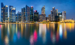 Beautiful Office building twilight with water reflection Singapore Stock Photo