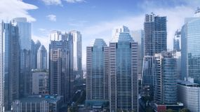 Beautiful office buildings under blue sky. Beautiful aerial view of office buildings under blue sky in Jakarta, Indonesia Stock Photography