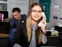 Beautiful office female worker talking on the phone. office concept Stock Photography