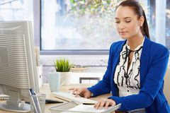 Beautiful office girl busy working royalty free stock photo