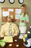 Beautiful Office Girl Covering Man in Yellow Sticky Notes stock images