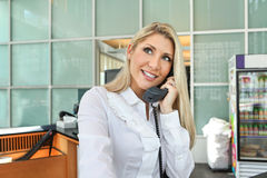A beautiful office lady talking on phone with smile Stock Image