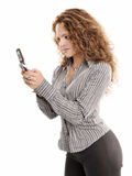 Beautiful office woman messaging by cellular phone Royalty Free Stock Photography