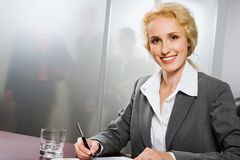 Beautiful office worker Stock Images