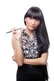Beautiful ofice manager with a pen. Royalty Free Stock Photo