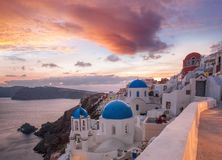Beautiful Oia village on Santorini island in Greece. Beautiful famous Oia village on Santorini island in Greece Royalty Free Stock Images
