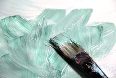 Beautiful oil painting and paintbrush Royalty Free Stock Photos