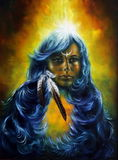 Beautiful oil painting of a woman on canvas with feathers Stock Photos