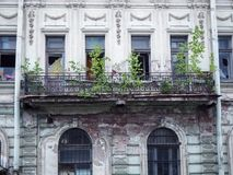 Beautiful old abandoned building with broken windows and a ruined balcony royalty free stock image