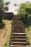 Beautiful old ancient stairway in  hinduist temple. Beautiful long high stairway in exotic rock ancient hinduist temple Royalty Free Stock Photo