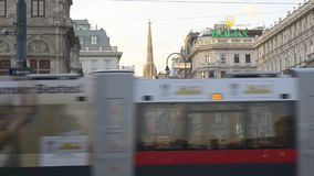 Beautiful old architecture of Vienna on busy street. VIENNA, AUSTRIA - AUGUST 2016: Beautiful old architecture of Vienna on sunset with Stephansdom (St. Stephen' stock video