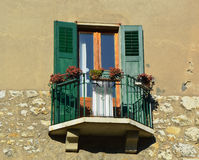 Beautiful old Balcony decorated with Flowers in Italy Stock Photo