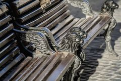 Beautiful old bench with iron lions royalty free stock image