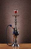 An old blue ceramic hookah on a blue background Stock Photography