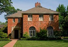 Beautiful old brick house. Lots of trees around the house Stock Photos
