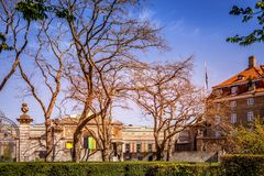 Beautiful old buildings and green bushes in empty park,. Copenhagen, denmark royalty free stock image