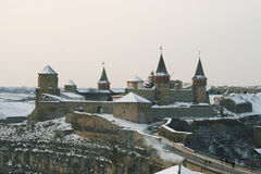 Beautiful old castle on the hill in winter. Stock Photos