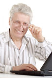 Beautiful old Caucasian man with laptop sits Stock Photos
