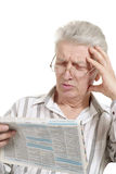 Beautiful old Caucasian man with newspaper sits Royalty Free Stock Photography