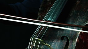 Beautiful old cello playing on a concert stock footage