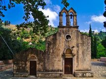 Beautiful old chapel facade. Beautiful old chapel facade in Crete island, Greece. Blue sky with some clouds royalty free stock image