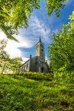 Beautiful old christian church in the wood Stock Photography